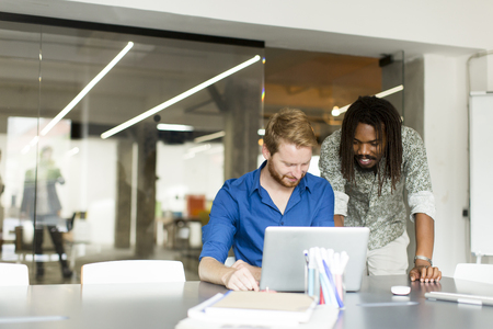 Multiracial male team working in office Stock Photo