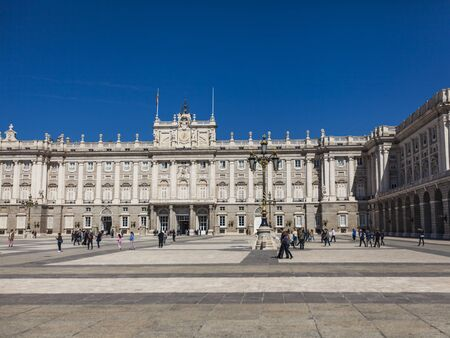 floo: MADRID, SPAIN - MARCH 13, 2016: Unidentified people in front of the Royal Palace in Madrid. It is the official residence of the Spanish Royal Family at the city of Madrid, but is only used for state ceremonies. The palace has 135,000 square metres of floo
