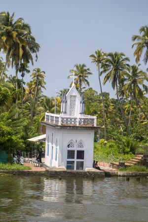 KERALA, INDIA - OCTOBER 16, 2015: Unindetified people at backwaters in Kerala, India. The backwaters are an extensive network of 41 west flowing interlocking rivers, lakes and canals that center around Alleppey, Kumarakom and Punnamada. Editorial
