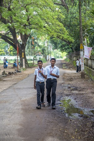 KERALA, INDIA - OCTOBER 17, 2015: Unindetified boys at backwaters in Kerala, India. The backwaters are an extensive network of 41 west flowing interlocking rivers, lakes and canals that center around Alleppey, Kumarakom and Punnamada.