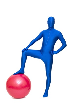 Mysterious blue man in morphsuit exercise with pilates  ball isolated on white Stock Photo