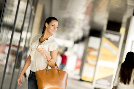 Young woman in shopping on street photo