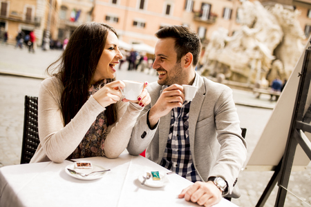 Loving couple drinking coffee in Rome, Italy 스톡 콘텐츠