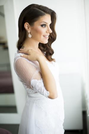 Young pregnant bride 写真素材