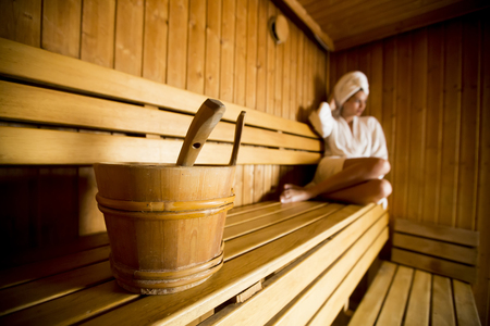 Young woman relaxing in the sauna at spa center 스톡 콘텐츠