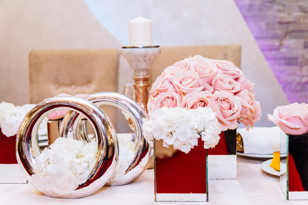 View at luxuriously decorated wedding table