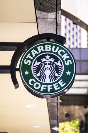 shopfront: SYDNEY, AUSTRALIA - FEBRUARY 12, 2015: Detail of the Stabucks coffee in Sydney, Australia. It is an American global coffee company and coffeehouse chain founded at 1971.