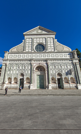 FLORENCE, ITALY - SEPTEMBER 22, 2016: Unidentified people in front of Basilica of Santa Maria Novella in Florence, Italy. It is the first great basilica in Florence opened at 1360.