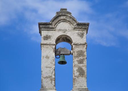 Old bell tower of Chiesetta di Santo Stefano in Polignano a Mare, Italy