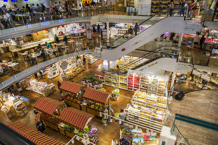 MILAN, ITALY - MAY 31, 2016: Unidentified people at Eataly Smeraldo in Milan, Italy. It is the biggest food market in Milan. Editorial