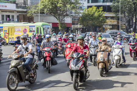 HO CHI MINH, VIETNAM - FEBRUARY 23, 2017: Unidentified people on the street of Ho Chi Minh, Vietnam. Ho Chi Minh is the largest city in Vietnam. Stock Photo - 76450775