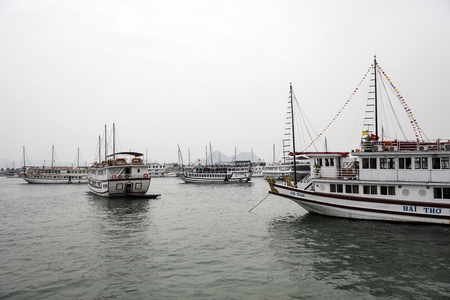 HALONG, VIETNAM - FEBRUARY 28, 2017: Tourist cruise ships port. Main industries at Hạlong is tourism, services, trading, agriculture, forestry and fishery