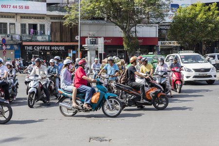HO CHI MINH, VIETNAM - FEBRUARY 23, 2017: Unidentified people on the street of Ho Chi Minh, Vietnam. Ho Chi Minh is the largest city in Vietnam. Stock Photo - 76511204