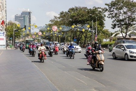 HO CHI MINH, VIETNAM - FEBRUARY 22, 2017: Unidentified people on the street of Ho Chi Minh, Vietnam. Ho Chi Minh is the largest city in Vietnam. Editorial