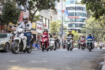 HO CHI MINH, VIETNAM - FEBRUARY 23, 2017: Unidentified people on the street of Ho Chi Minh, Vietnam. Ho Chi Minh is the largest city in Vietnam. Stock Photo - 77201527