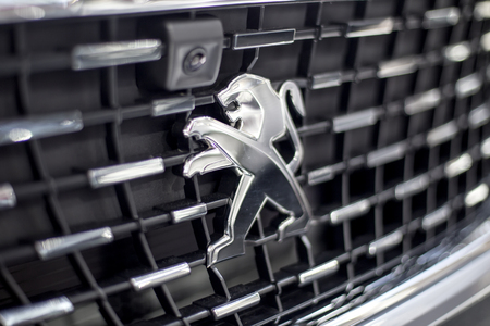 BELGRADE, SERBIA - MARCH 28, 2017: Detail of the Peugeot car at Belgrade, Serbia. Peugeot as car manufacturer was founded at 1882. Фото со стока - 77201538