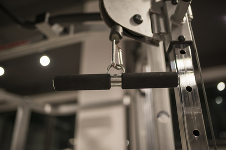 Detail from pulling exercise machine in the gym Фото со стока