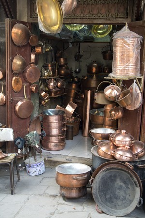 Shop with traditional crafts in the narrow street of Fes, Morocco
