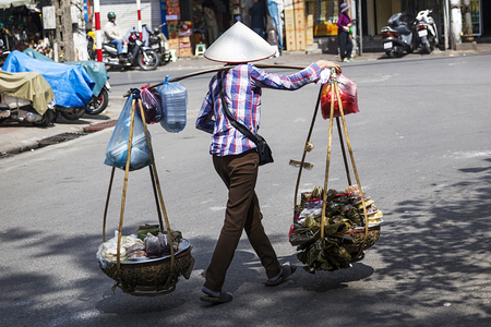 HANOI, VIETNAM - MARCH 2, 2017: Unidentified man on the street of Hanoi, Vietnam. Hanoi is capital of Vietnam and have more than 7,5 million citizens.
