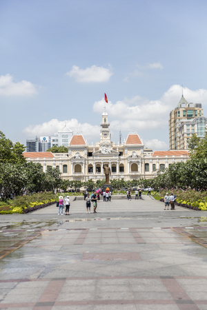 HO CH MINH, VIETNAM - FEBRUARY 22, 2017: Unidentified people in front of Ho Chi Minh City Hall, Vietnam. Cty Hall was built in French colonial style and was finished at 1908. Editorial