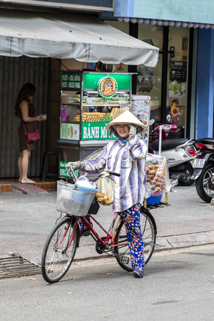 HO CHI MINH, VIETNAM - FEBRUARY 22, 2017: Unidentified people on the street of Ho Chi Minh, Vietnam. Ho Chi Minh is the largest city in Vietnam. Stock Photo - 77992430