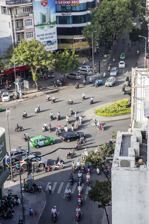 HO CHI MINH, VIETNAM - FEBRUARY 22, 2017: Unidentified people on the street of Ho Chi Minh, Vietnam. Ho Chi Minh is the largest city in Vietnam. Stock Photo - 81395418