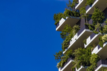 MILAN, ITALY-APRIL 28, 2017: Detail of the Bosco Verticale in Milan, Italy. It is a pair of residential towers in the Porta Nuova district of Milan that host more than 900 trees. Stock Photo