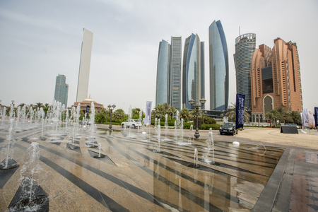 ABU DHABI, UAE - MAY 4, 2015: View at Etihad Towers in Abu Dhabi, United Arab Emirates. It is a complex of buildings with five towers in Abu Dhabi.