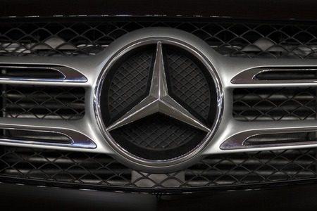 BELGRADE, SERBIA - MARCH 28, 2017: Detail of the Mercedes car. Company became known as Daimler-Benz AG, later Mercedes-Benz using its trade name. Stock fotó - 77943866