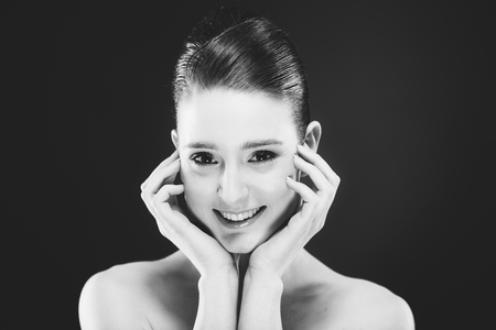 Portret of pretty young smiling woman Stock Photo