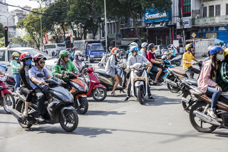 HO CHI MINH, VIETNAM - FEBRUARY 23, 2017: Unidentified people on the street of Ho Chi Minh, Vietnam. Ho Chi Minh is the largest city in Vietnam. Stock Photo - 78123981