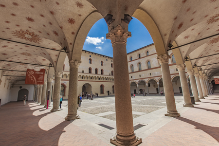 MILAN, ITALY - APRIL 30, 2017: Unidentified people in Sforzesco castle in Milan, Italy. Castle was built in the 15th century by Francesco Sforza, Duke of Milan.