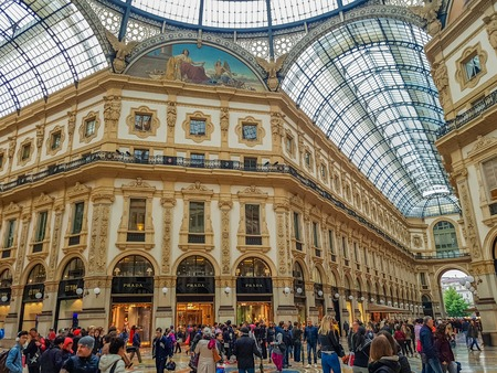 MILAN, ITALY - APRIL 26, 2017: Unidentified people at Galleria Vittorio Emanuele II in Milan. It is one of the worlds oldest shopping malls, opened at 1877.