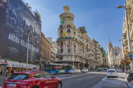 MADRID, SPAIN - MARCH 16, 2016: Unidentified people at Gran Via street in Madrid, Spain. GranVia is considered a showcase of early 20th century architecture Editorial