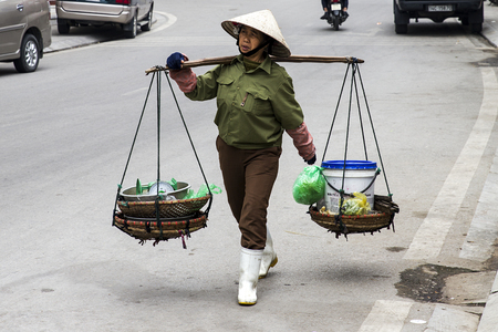 HALONG, VIETNAM - FEBRUARY 28, 2017: Unidentified man on the street of Halong, Vietnam. Halong city is a major industrial center in Northern Vietnam and one of biggest ports