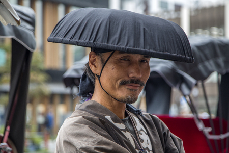 TOKYO, JAPAN - OCTOBER 3, 2016: Unidentified  rickshaw runner at Asakusa district in Tokyo, Japan. Rickshaws are believed to have been invented in Japan in the 1860s