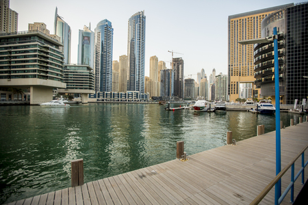 DUBAI, UAE- MAY 6, 2015: View at modern skyscrapers in Dubai Marina in Dubai, UAE. When the entire development is complete, it will accommodate more than 120,000 people.