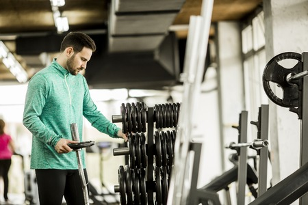 young man preparing for a workout in the gym Stock Photo