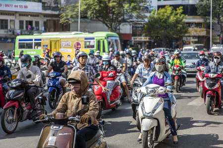 HO CHI MINH, VIETNAM - FEBRUARY 23, 2017: Unidentified people on the street of Ho Chi Minh, Vietnam. Ho Chi Minh is the largest city in Vietnam.