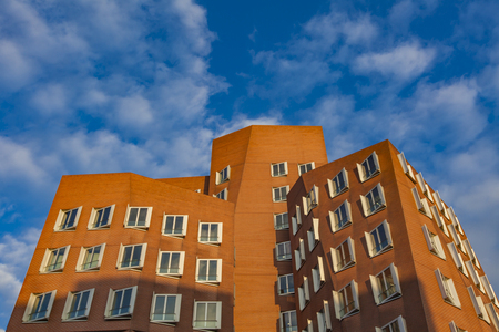 DUSSELDORF, GERMANY- NOVEMBER 8, 2011: Gehry buildings in Duesseldord, Germany. The Gehry Buildings in Dusseldorf Harbor are  wonderful representatives of postmodern architecture.