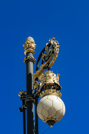 Street lights by Royal palace in Madrid, Spain