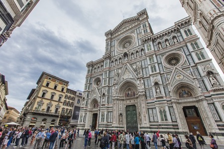 FLORENCE, ITALY - SEPTEMBER 18, 2016: Unidentified people in front of Florence cathedral in Italy. This cathedral is the main church of Florence