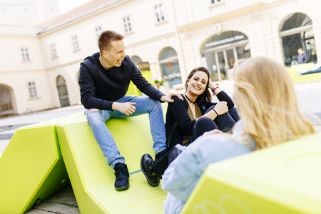 Young people sitting on the lounge seats in Vienna, Austria