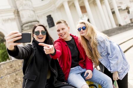 Young people taking selfie on street in Vienna, Austria