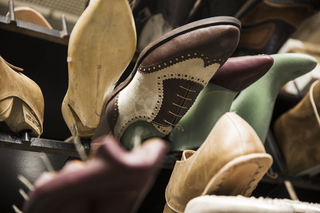 Closeup of the shoes on the sleves in the shoemaker workshop Stock Photo
