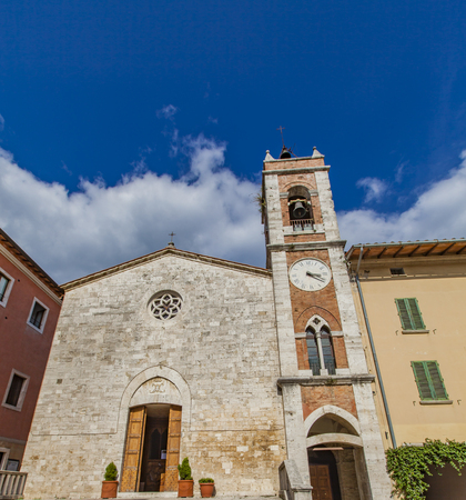 Belfry of Saint Francis church in San Quirico dOrcia. Tuscany, Italy