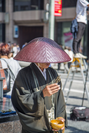 TOKYO, JAPAN - OCTOBER 2, 2016: Unidentified man on the street in Ginza, Tokyo. Ginza is a popular upscale shopping area of Tokyo.