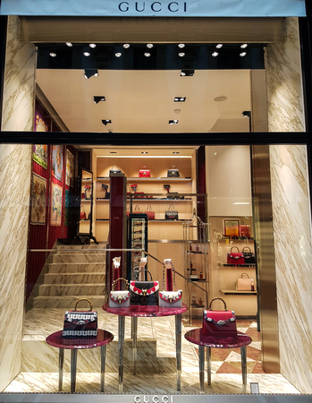 MILAN, ITALY - APRIL 26, 2017: Gucci shop in Milan, Italy. Gucci is an Italian fashion and leather goods brand founded at 1921.