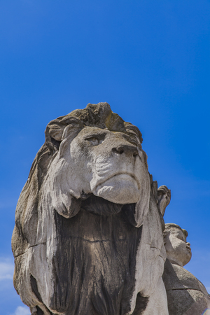 Statue Lion a lenfant by Georges Gardet from 1900 at Pont Alexandre III in Paris, France