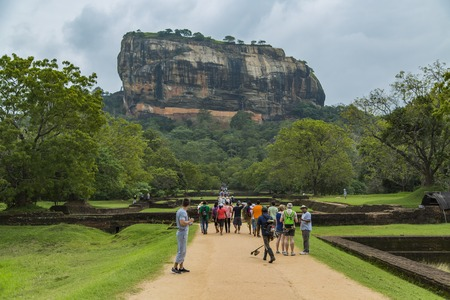 SIGIRIYA, SRI LANKA - JANUARY 28, 2014: Unidentified people at Sigiriya rock fortress in Sri Lanka. Sigiriya rock fortress is designated as world heritage site since 1982 Editorial